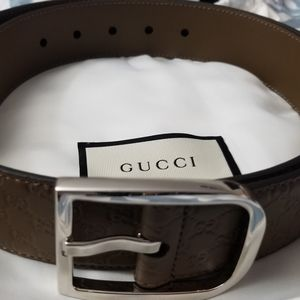 Embossed Gucci Men's belt